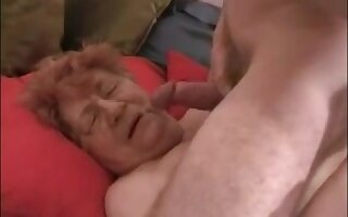 Big fat granny get a facial by a young dick