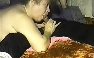 chunky big beautiful woman sucks her husbands schlong in this vintage porn movie
