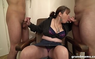 Mature German battle-axe wants her slaves close to suck her chunky tits