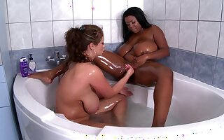 Chubby ebony woman in the scrubbing with a busty white mom out of reach of fire